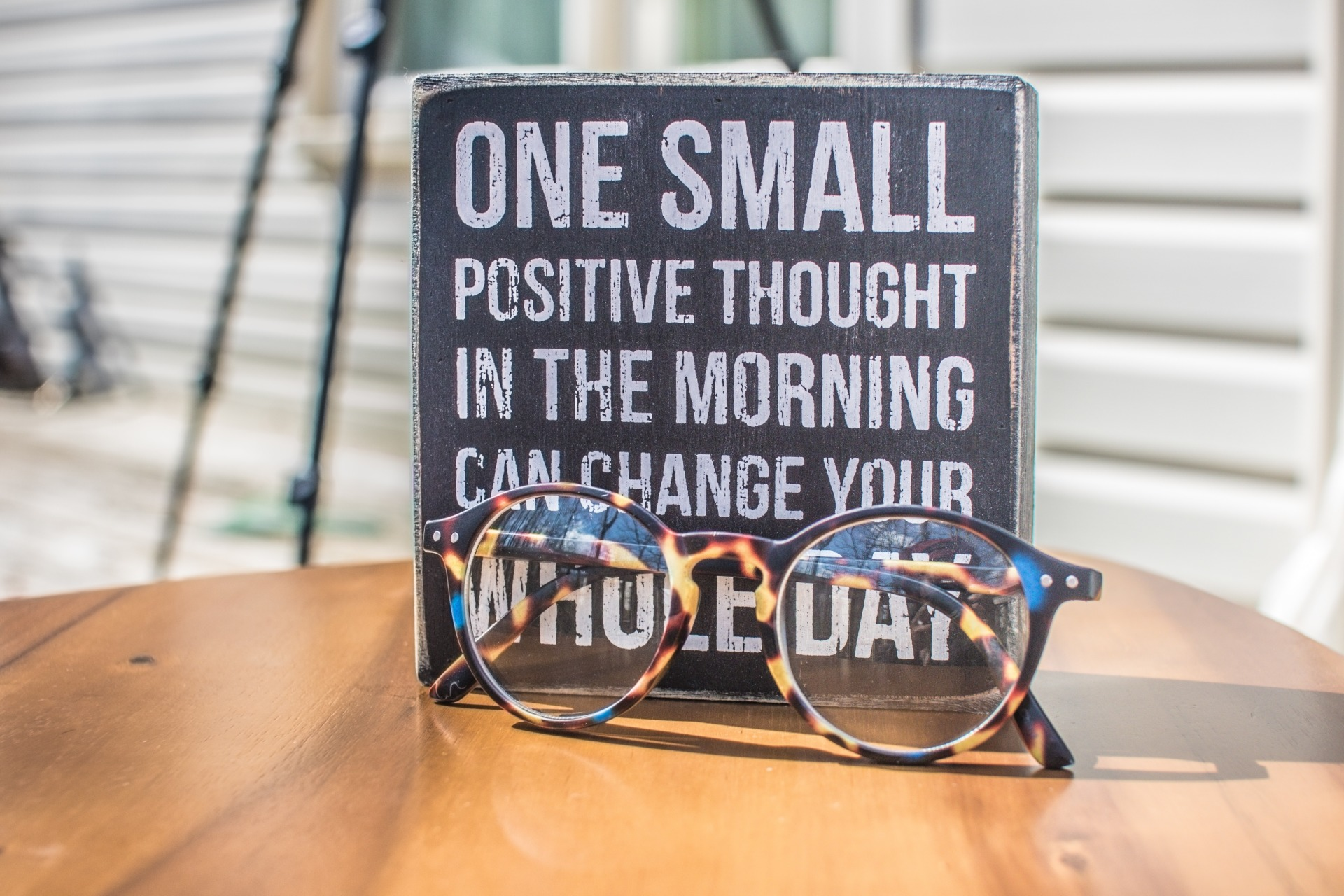 photo of a sign and eyeglasses on table 1485657 | Lissa De Dycker